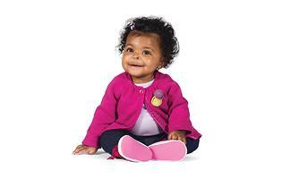 baby girl wearing pink sitting on floor