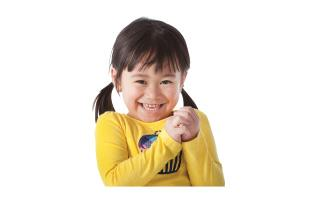 toddler wearing yellow smiling and clapping