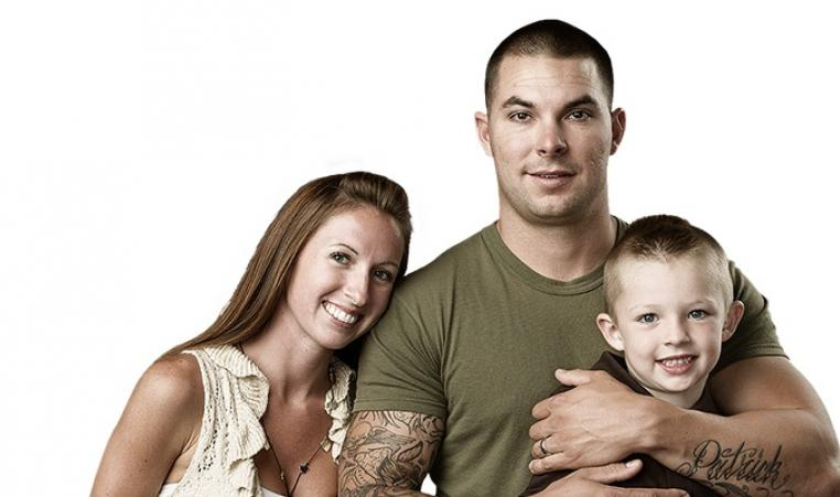 Military soldier with wife and son
