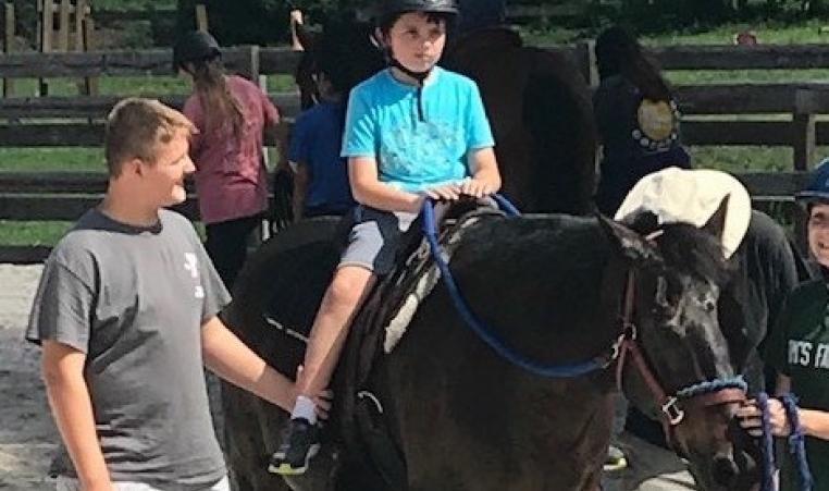 camp coast camper liam on a horse