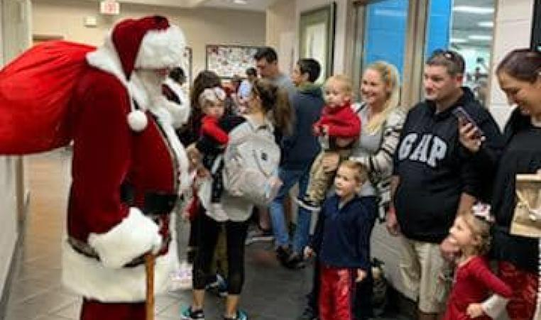 Santa visits the Greater Palm Harbor Y