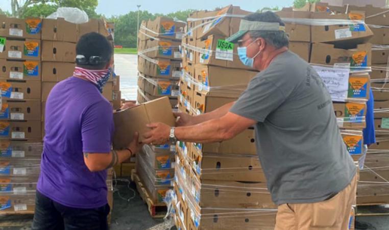 James P. Gills Y volunteers handle food