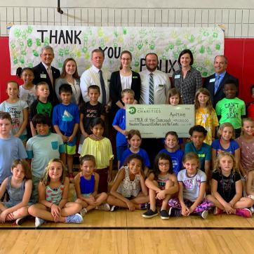 YMCA Campers pose with check donated by Publix Charities