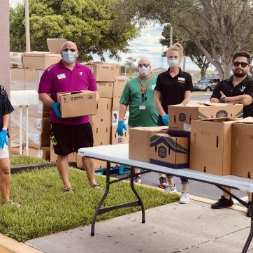 The YMCA of the Suncoast's West Pasco branch, located at 8411 Photonics Dr. in Trinity, works with Feeding Tampa Bay to hand out food to needy families on April 6, 2020.