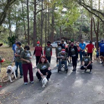 group of people in park for reindeer run 2020 and a few dogs